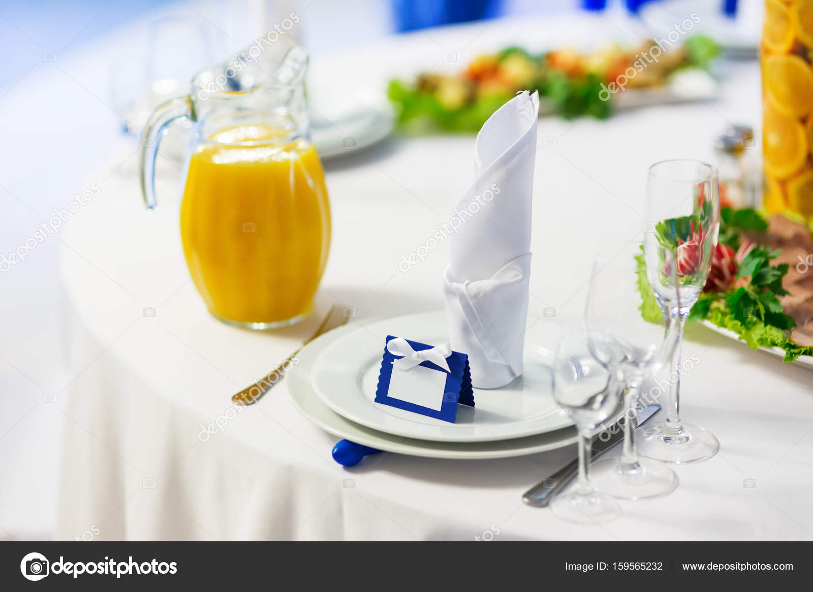 Table set for wedding banquet with cutlery. Salads, appetizers and ...