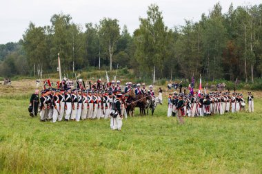 BORODINO, RUSSIA - September 02, 2017 - Reenactment of the battle of Borodino (the Patriotic war of 1812 year). Tourists watch the performance from from the fenced places. Moscow region, Russia.