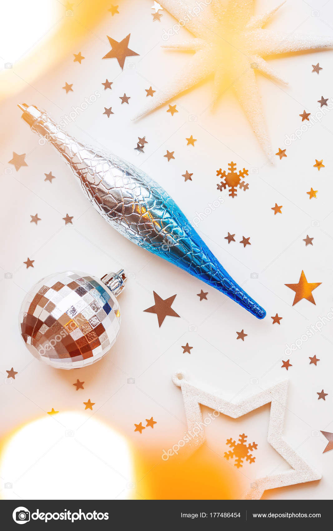 6634da10691b Christmas and New Year holiday background with decorations and light bulbs.  Silver and blue shining ball, white snowflakes and star confetti. Flat lay,  top ...