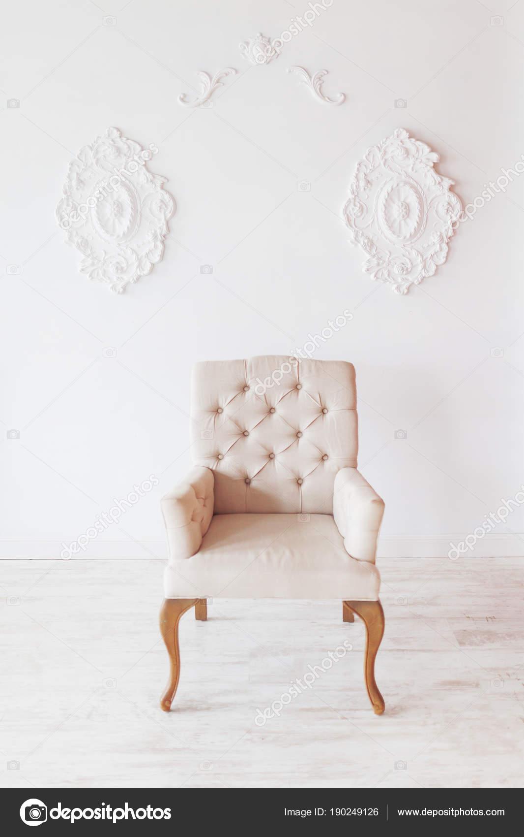 Beige Chair On White Wall Background With Swirl Decorations. Studio  Interior. U2014 Photo By Aksenovko