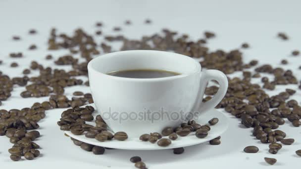 Cup of coffee on white background with seeds. Close up on a coffee cup with seed around and hot coffee.