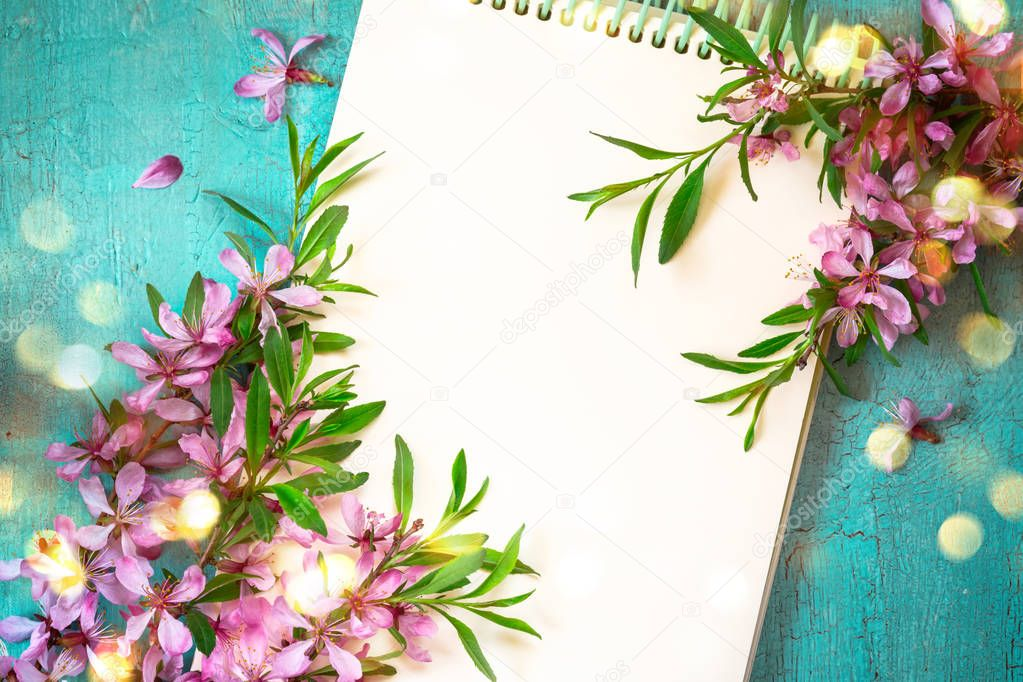 Spring Festive background with notepad and blooming almond