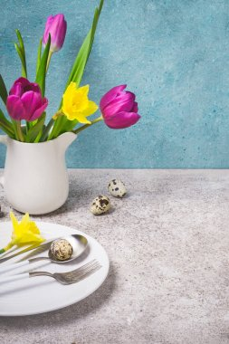 Spring Easter Table setting with flowers and Eggs