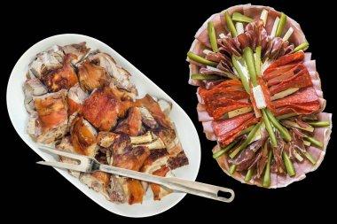 Plateful of Spit Roasted Pork Shoulder Slices and Serbian Appetizer Savory Dish Meze Isolated on Black Background