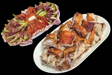 Plateful of Spit Roasted Pork Slices and Serbian Appetizer Savory Dish Meze Isolated on Black Background