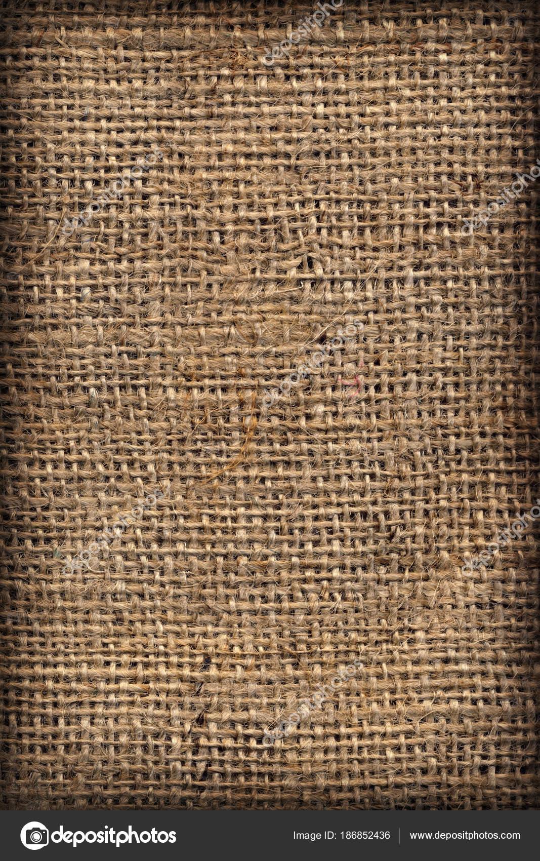 High Resolution Natural Brown Burlap Canvas Coarse Grain Vignette Grunge Background Texture Stock Photo