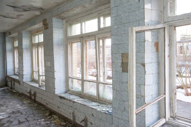 windows frames and blue tile wall