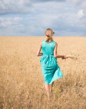 Girl walking  on meadow