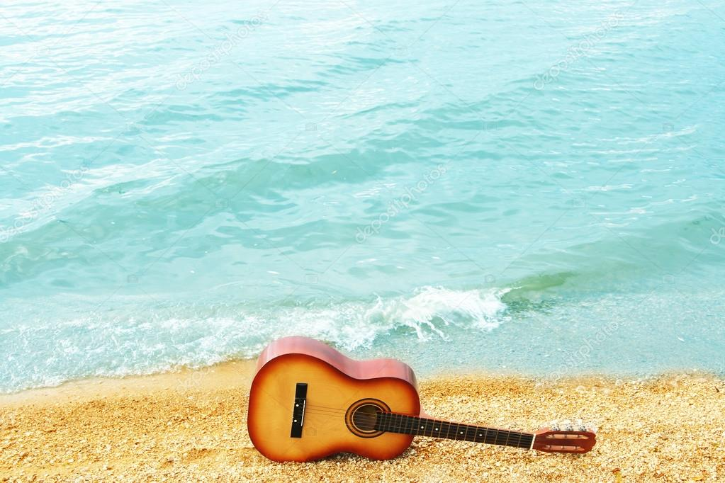 guitar on  sand  on  coast