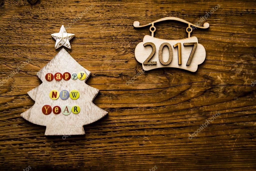 Rbol de navidad de madera y n mero 2017 foto de stock for Adornos navidenos 2017 trackid sp 006