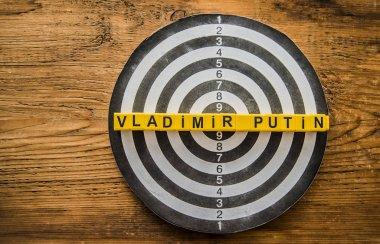 Vladimir Putin words on dartboard