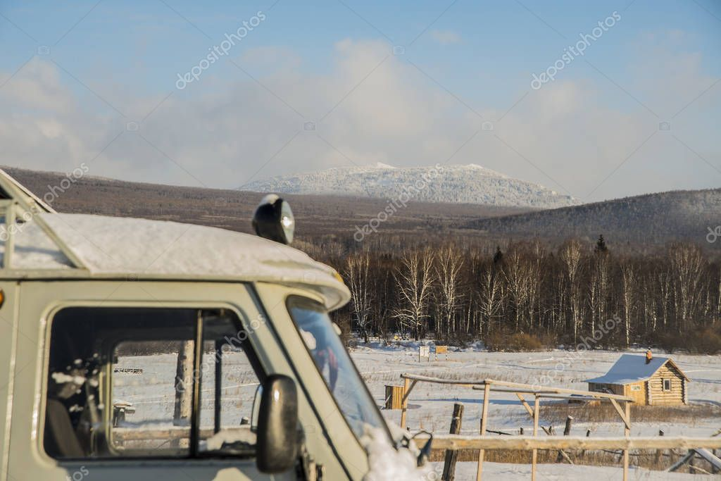 mountain Iremel and snowy SUV car