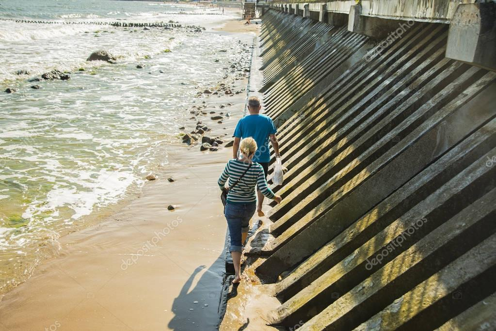 people walking along beach