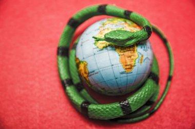 Green Snake around Earth