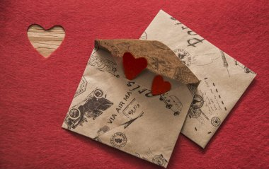 Envelopes with couple of red hearts