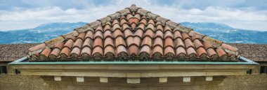 house with  tile brown roof