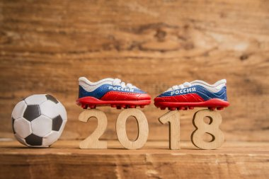 football ball and boots with tricolor