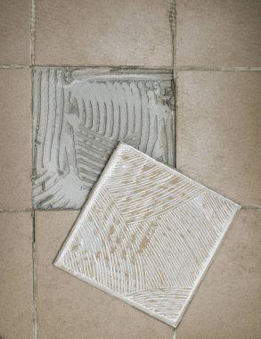 ceramic tile on the floor. Home improvement, renovation -  tiling, ceramic tiles