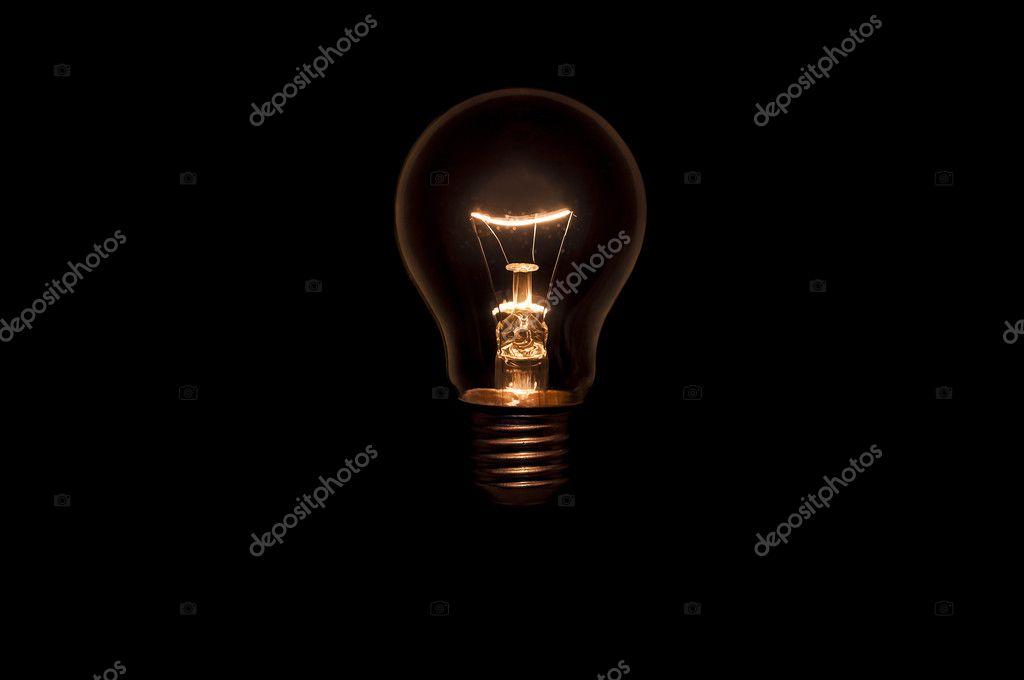 Wolfram-Glühlampe auf schwarzem Hintergrund — Stockfoto © jpiman ...