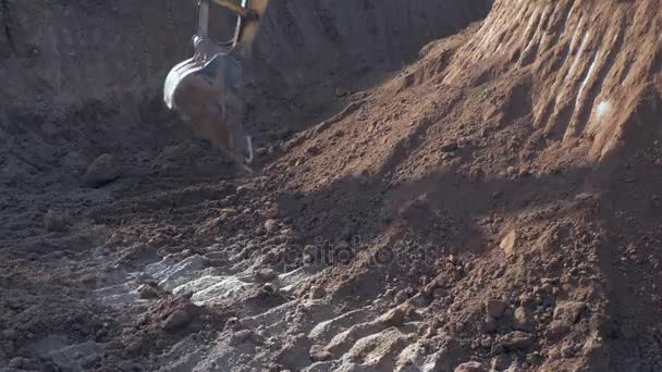 close up of an excavator digging earth at site
