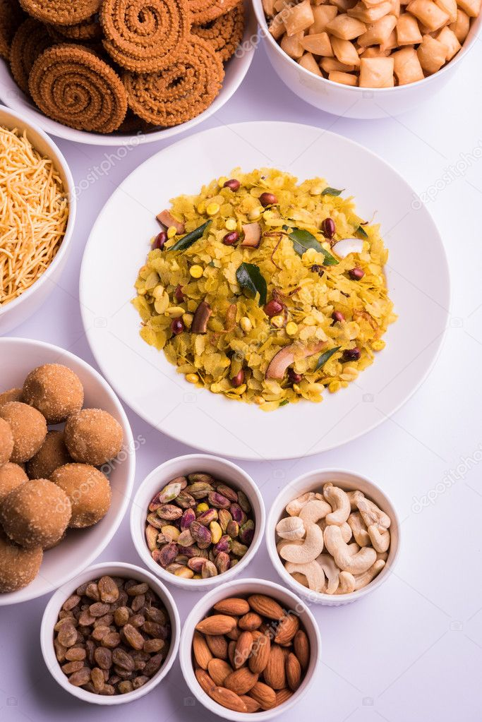 Home made tasty diwali food or diwali snacks or diwali sweets like home made tasty diwali food or diwali snacks or diwali sweets like rava laddu chakli sevshankar pale and chivda or chiwada with dry fruits in white bowls forumfinder Image collections