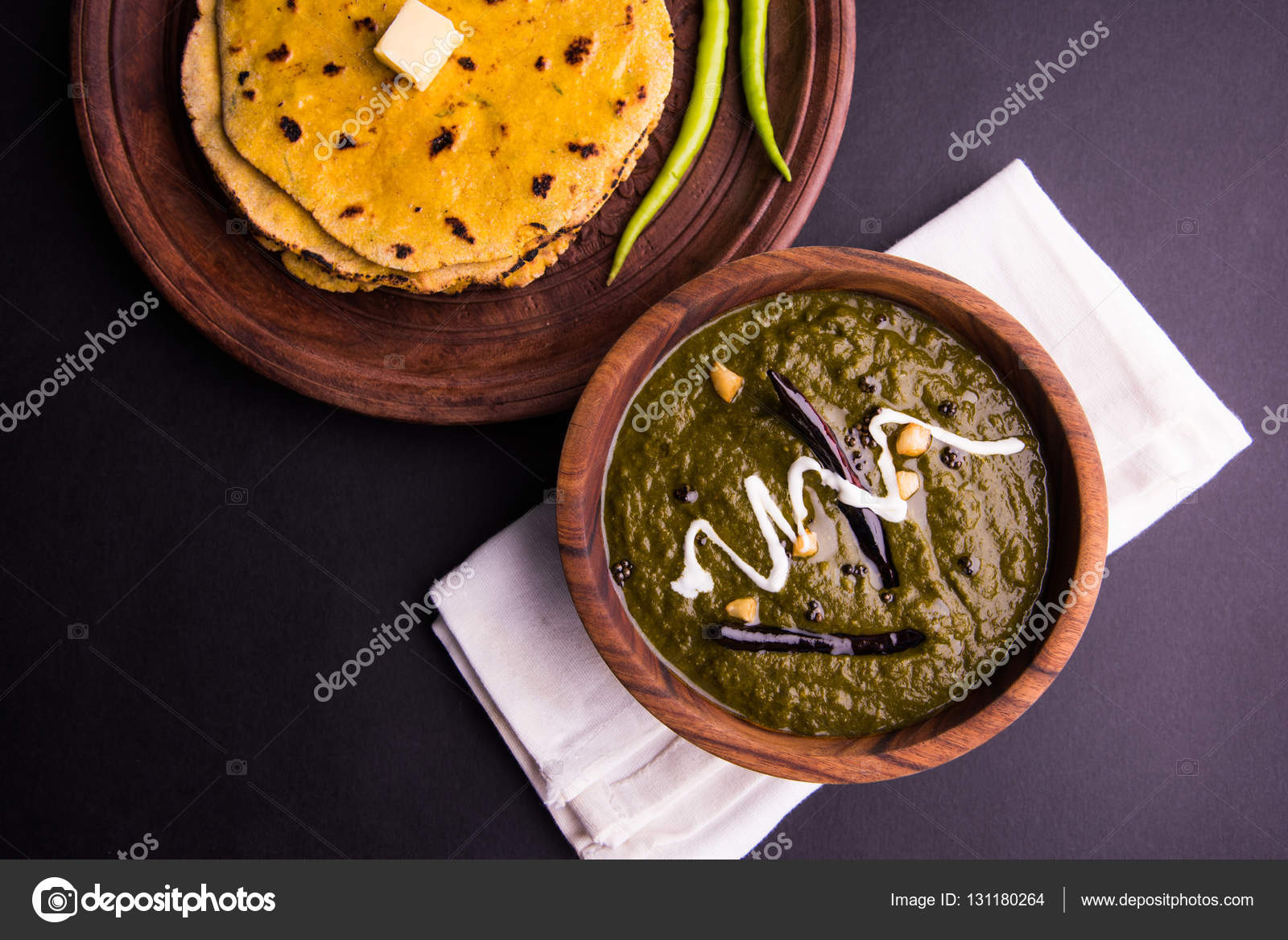 Corn flour flat bread or roti or makki ki roti with sarso da saag or corn flour flat bread or roti or makki ki roti with sarso da saag or mustard leaves curry indian food popular in winter season in north india photo by forumfinder Images