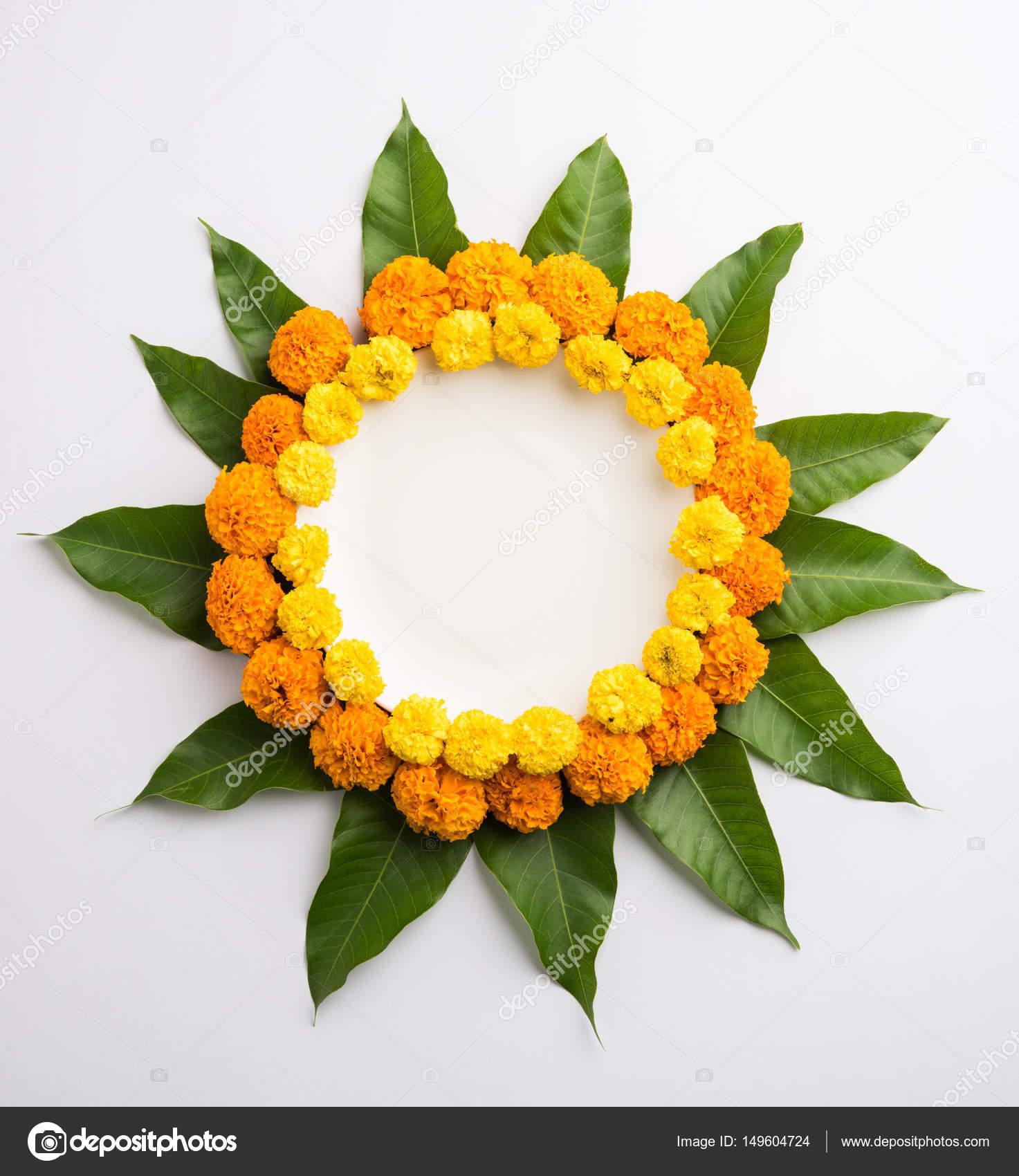 Flower Rangoli Made Using Marigold Or Zendu Flowers And Mango Leaves Over Black Background With Copy