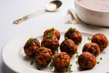 Gobi or veg Manchurian dry or with gravy - Popular street food of India made of cauliflower florets, selective focus