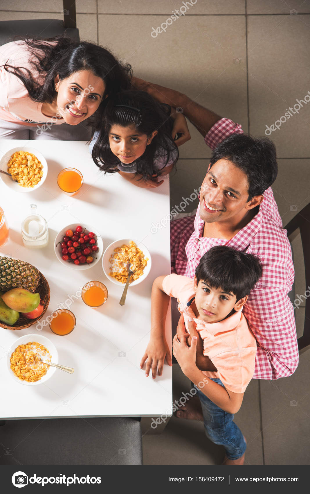 Top View Of Happy Smiling Asian Indian Family Mother Father Son And Daughter Eating Healthy Food Salad At A Dining Table Indians Breakfast