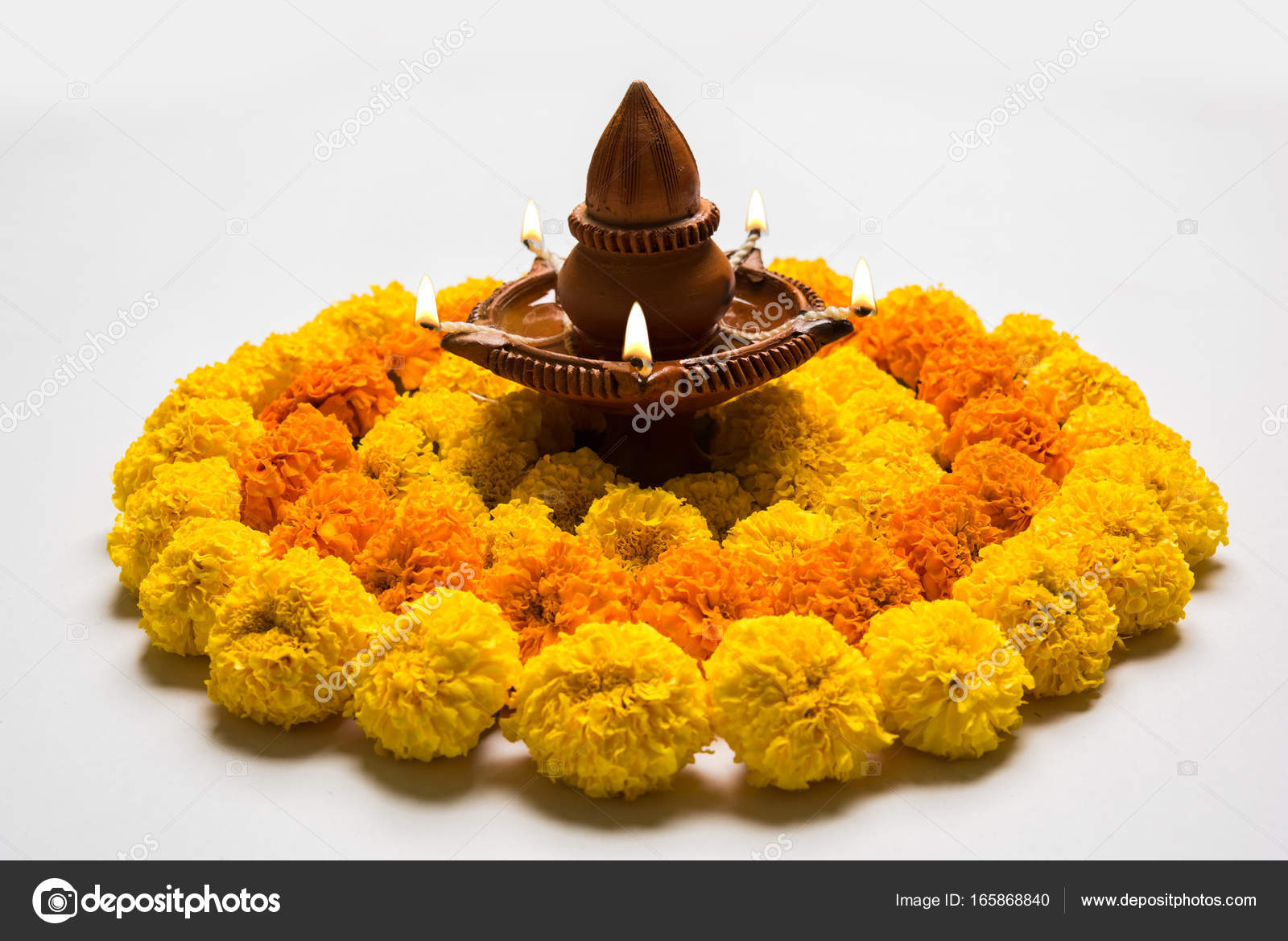 Clipart Rangoli Flower Rangoli For Diwali Or Pongal Or Onam Made Using Marigold Or Zendu Flowers And Red Rose Petals Over White Background With Diwali Diya In The Middle Selective Focus