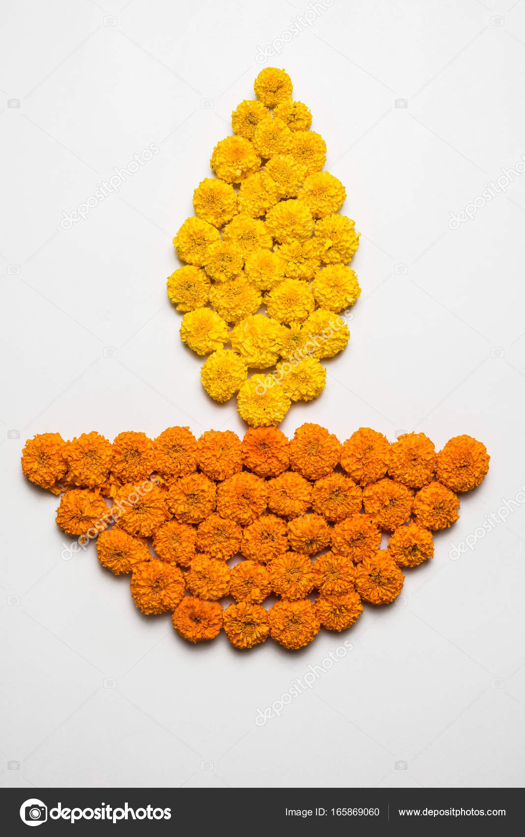 Flower Rangoli For Diwali Or Pongal Or Onam Made Using Marigold Or Zendu Flowers And Red