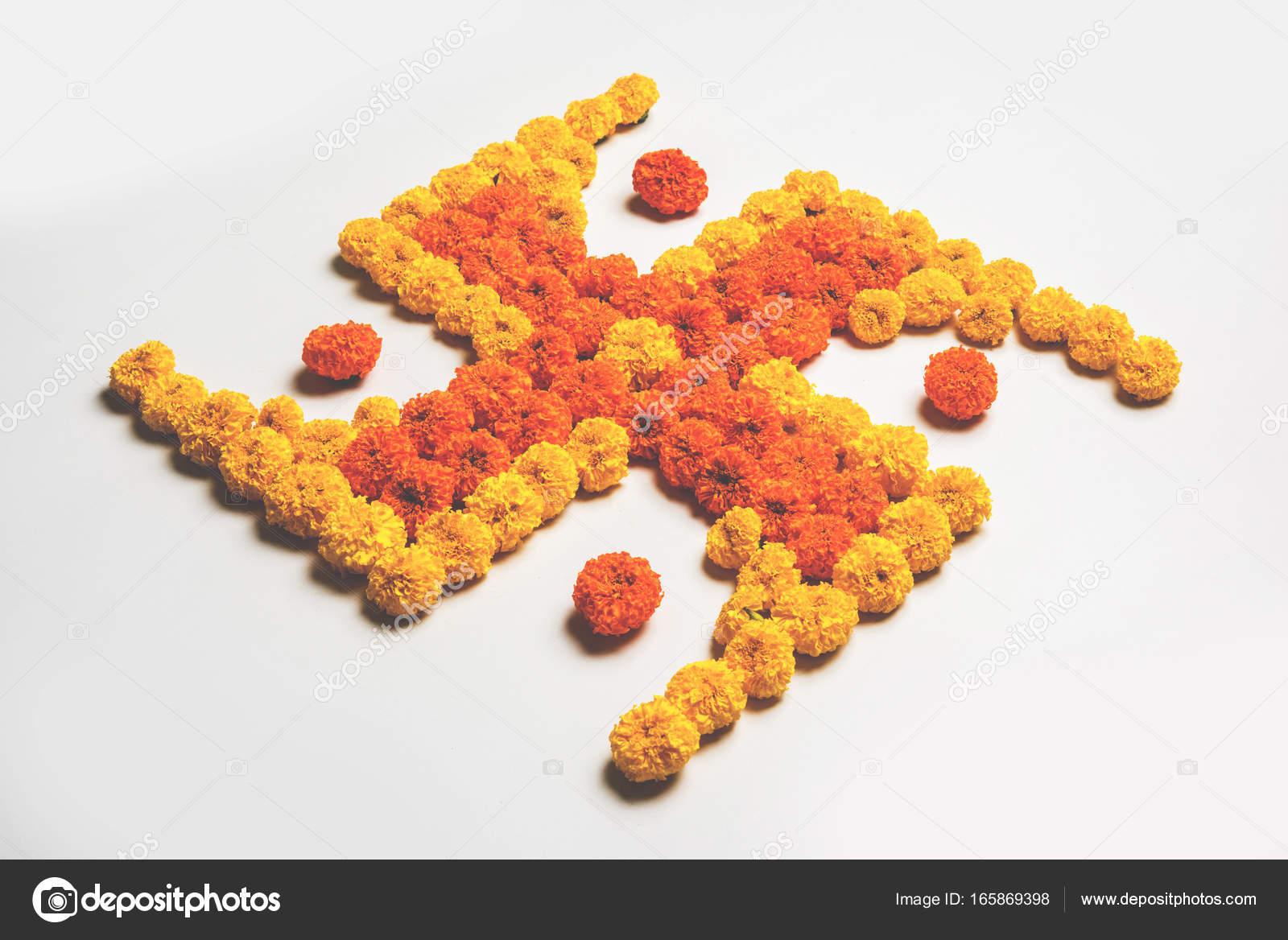 Stock photo of hindu auspicious symbol called swastika made using stock photo of hindu auspicious symbol called swastika made using marigold flower or zendu or genda biocorpaavc