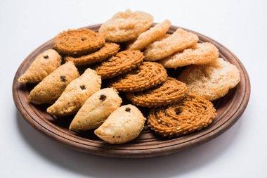 Stock photo of Indian festival or diwali food called chakli, anarsa and karanji or Gujiya, selective focus stock vector
