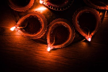 Diya in Thali - Brass Plate or thali full of Terracotta diya or oil lamps ready for decorating or illuminating house on diwali, a festival of light. selective focus stock vector