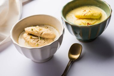 Ras malai or Rasmalai or rossomalai is Indian dessert food made using Jaggery or gur and sugar. It is a rich cheesecake without a crust