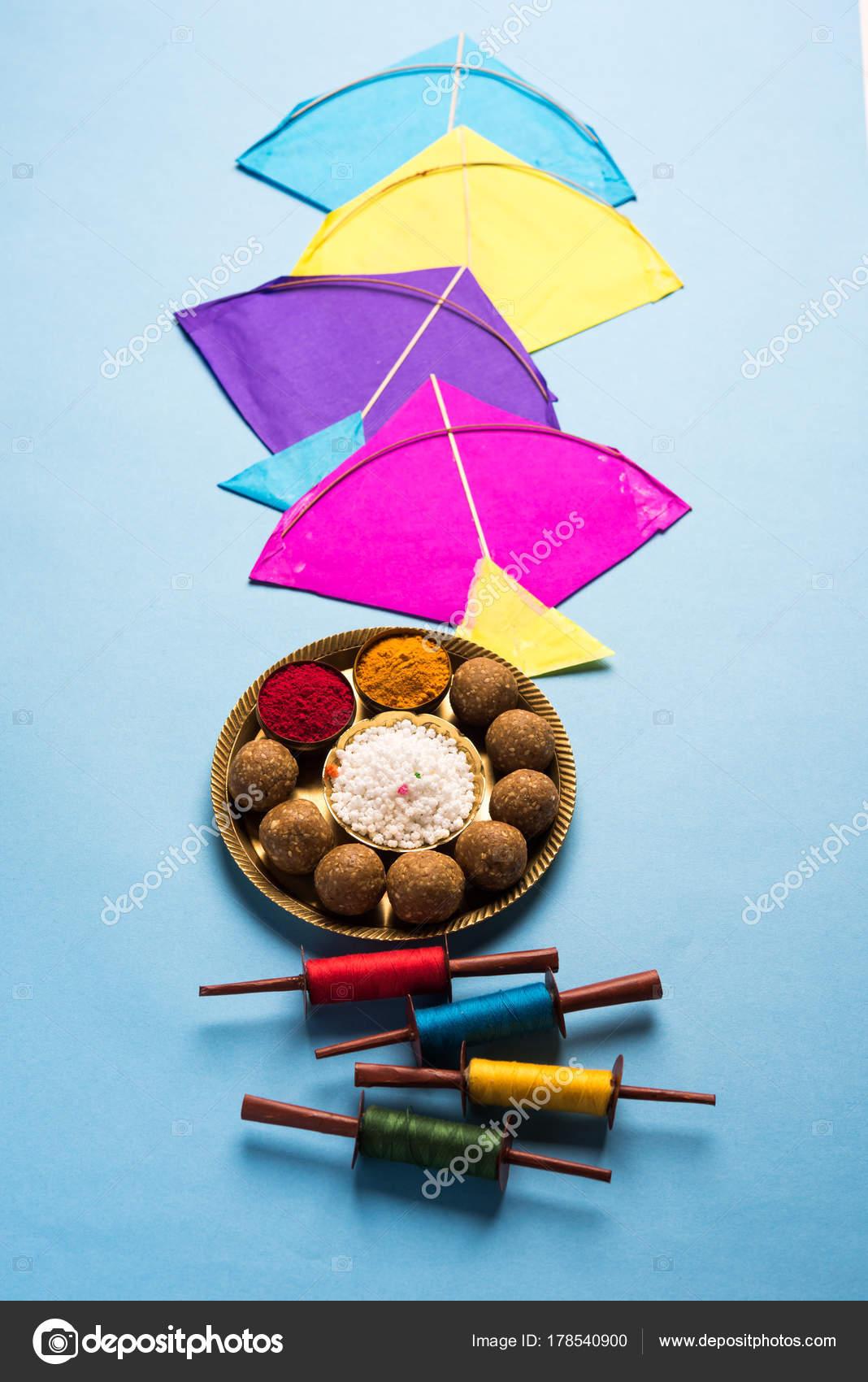 Happy makar sankranti greeting card tilgul til ladoo bowl plate happy makar sankranti greeting card tilgul or til ladoo in a bowl or plate with haldi kumkum and flowers with fikri reelchakri spool with colourful m4hsunfo
