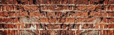Old red brick wall. Erosion of red clay. Texture of an old brick wall