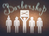 Barbershop concept. Cut out of white paper little men illustrate the skill of the hairdresser to model different haircuts