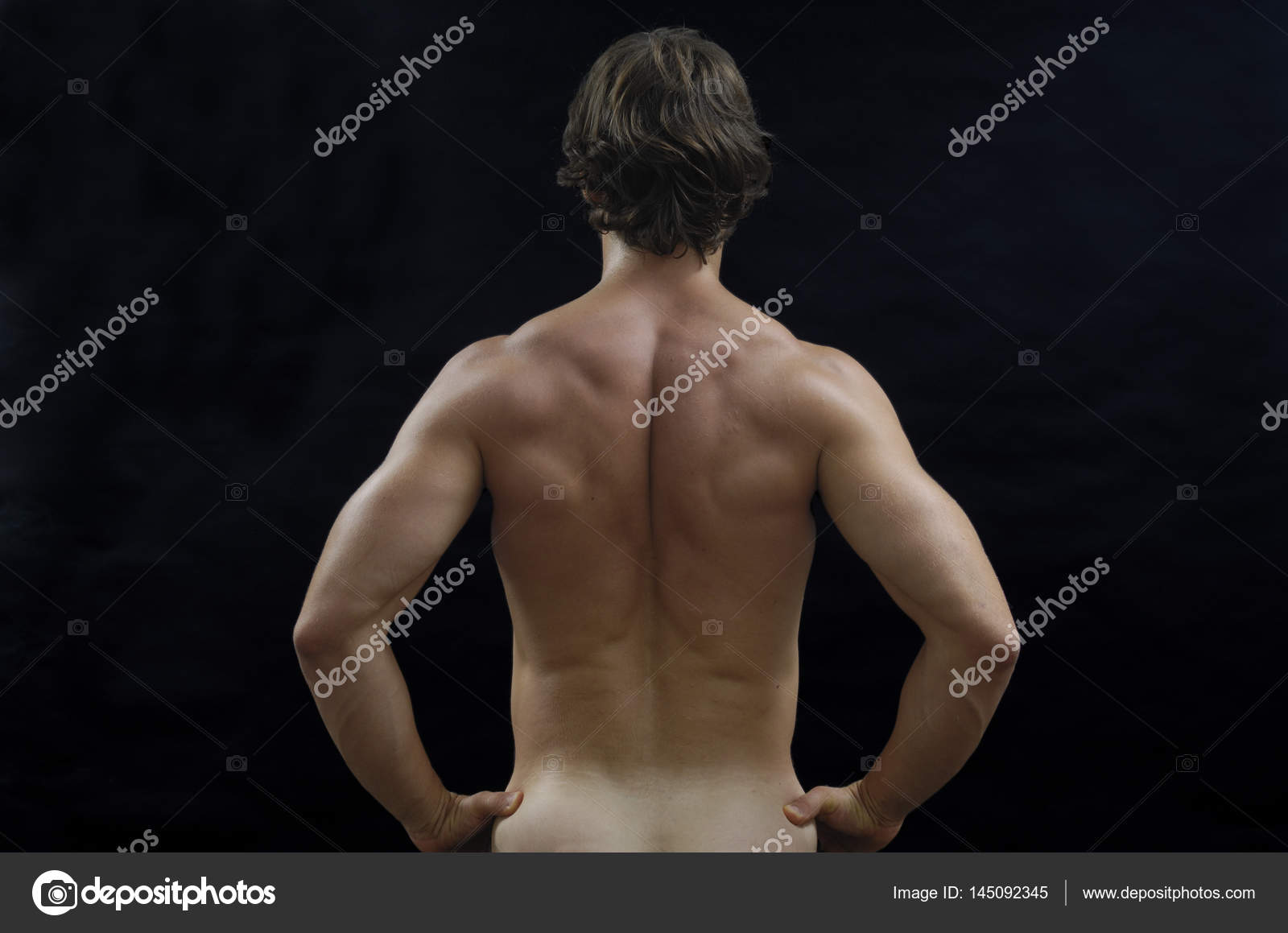 Naket Man On Back On Black Stock Photo