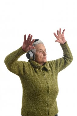 Senior woman dancing with white background