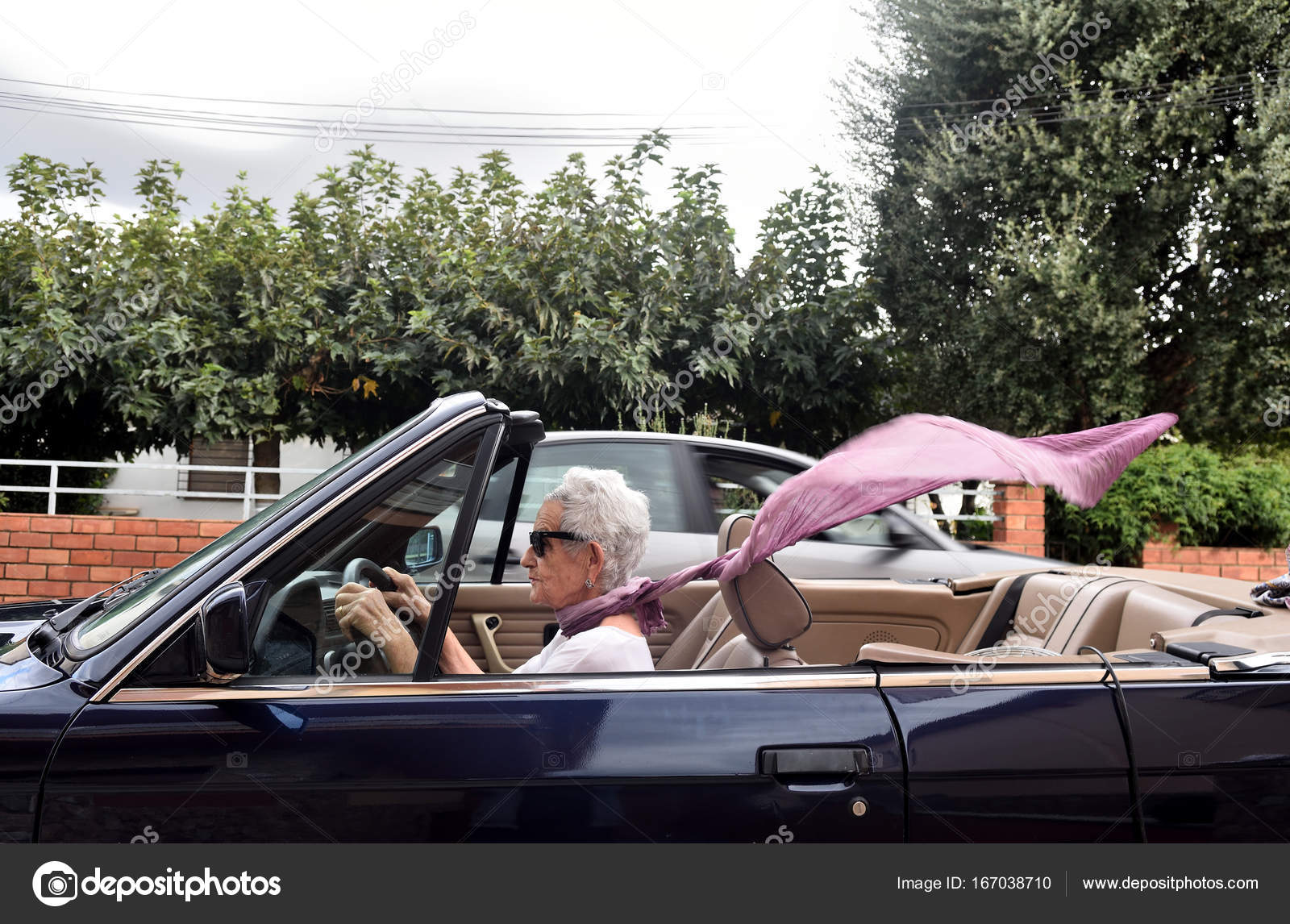 old woman driving a convertible car — Stock Photo © MariaiC #167038710