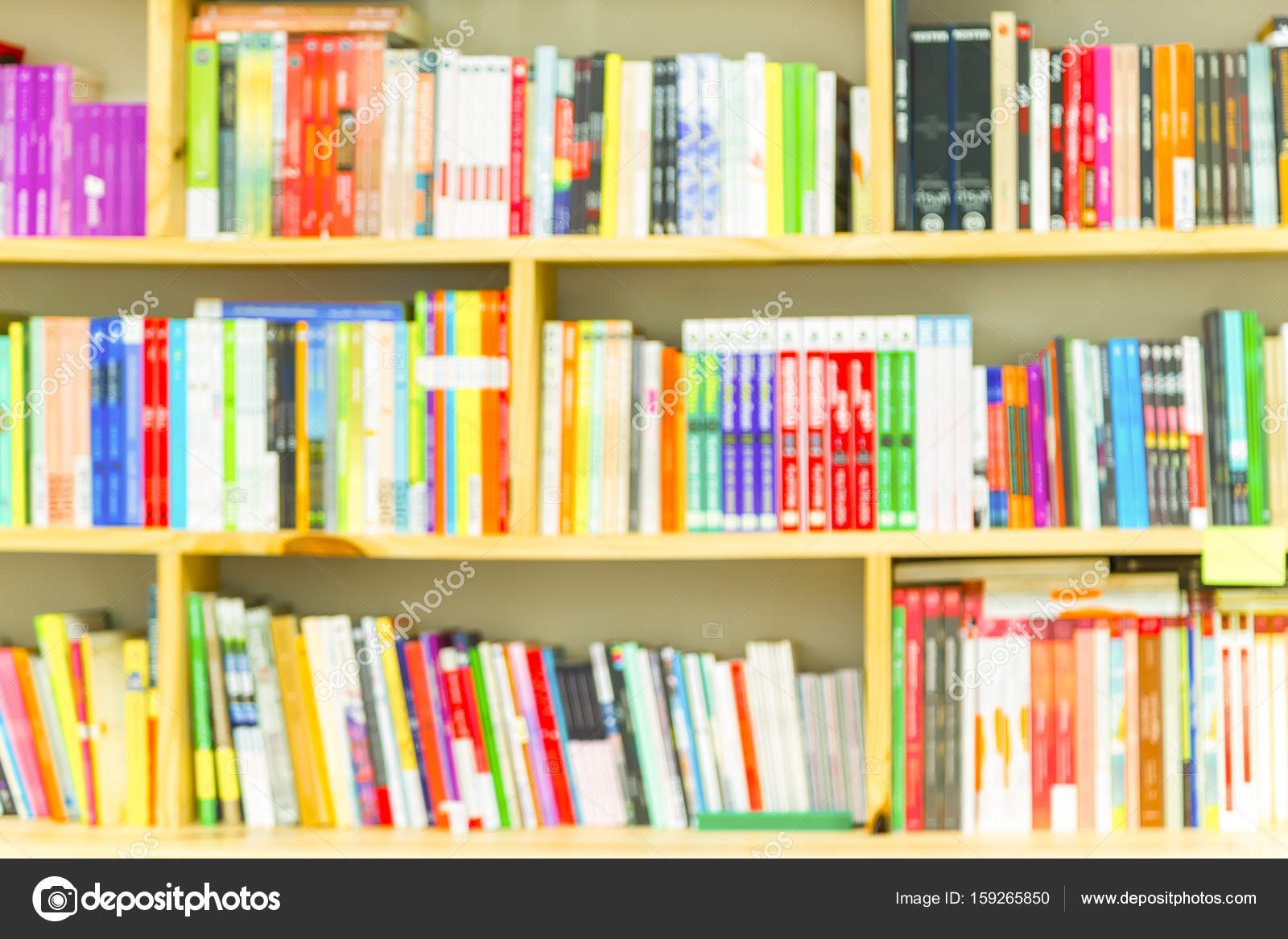 Books On Bookshelf In Library Room Abstract Blur De Focused Bac Stock Photo