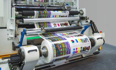Large offset printing press or magazine running a long roll off