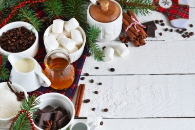 Ingredients for hot chocolate for the new year with space for te