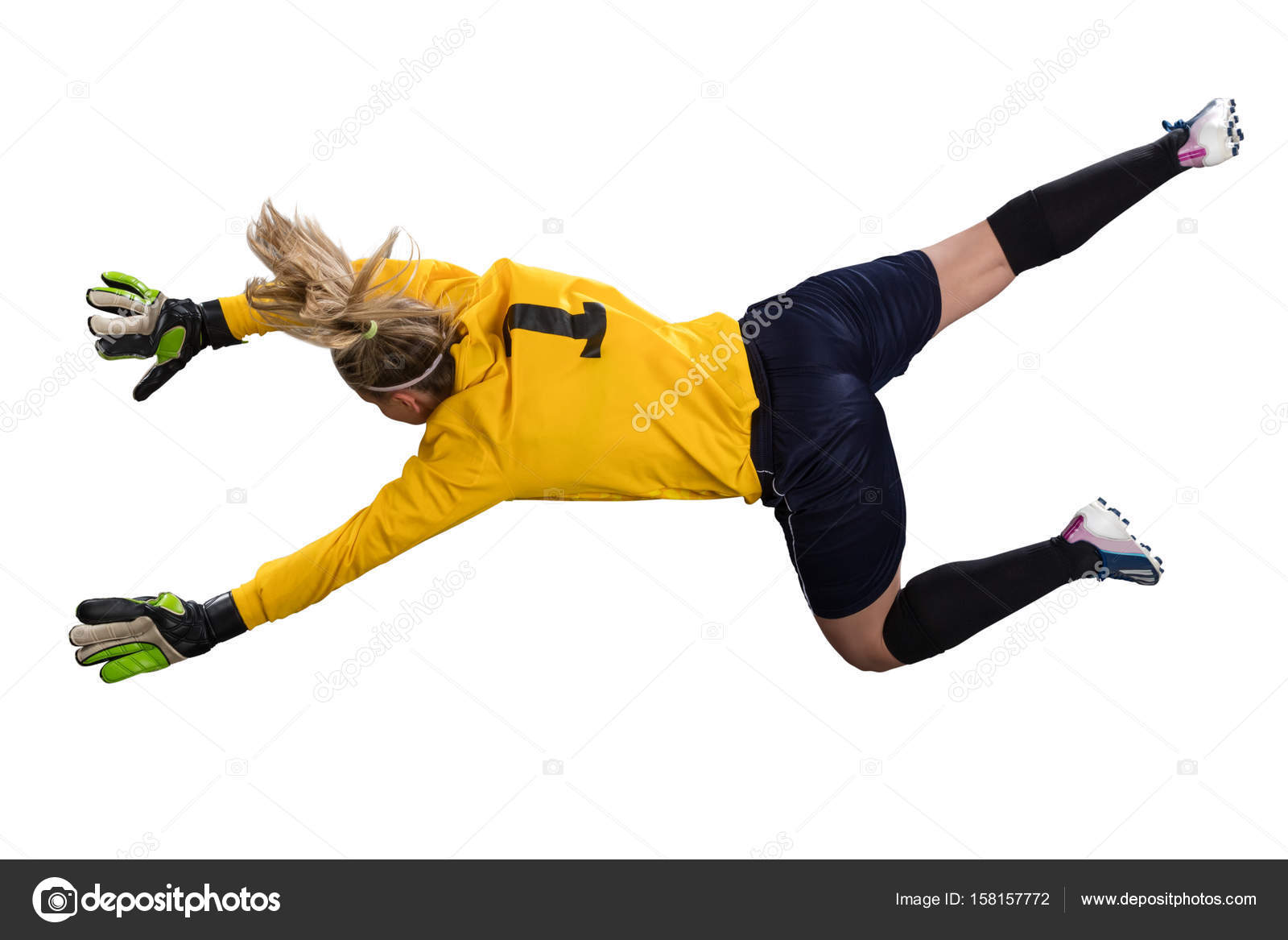 female goakeeper jumping for the ball isolated on white background