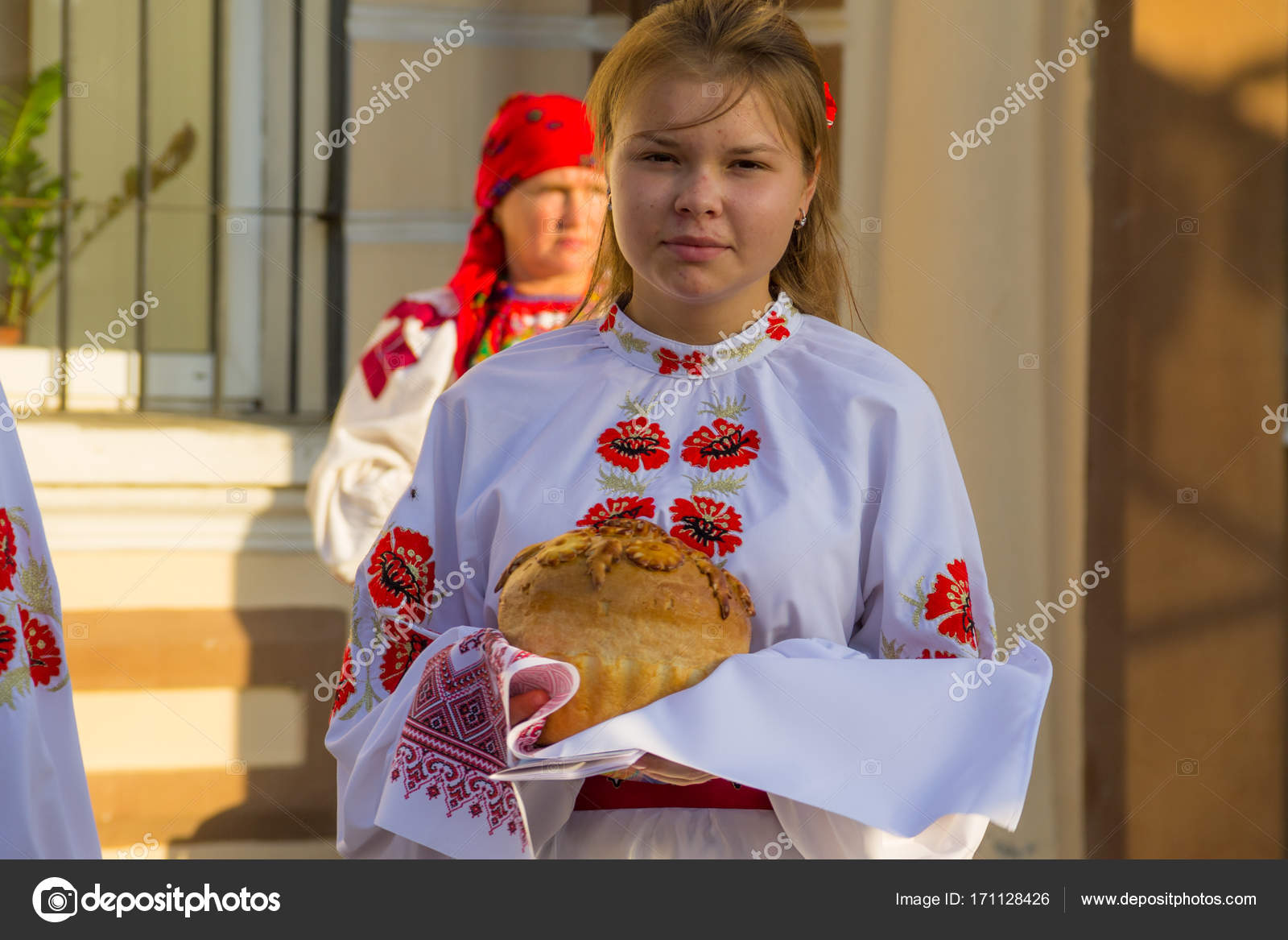 Girls In Ukrainian Traditional Clothing Prepare To Welcome Guest Stock Photo