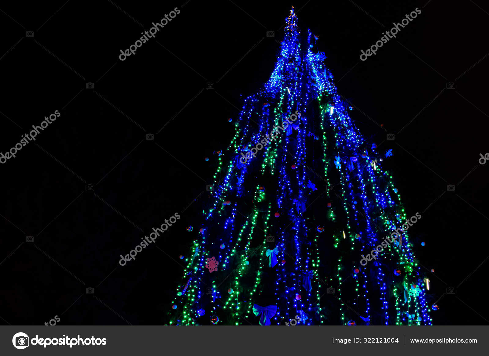 Decorated Christmas Tree With Multi Colored Lights At Night Stock Photo C Olyasolodenko 322121004