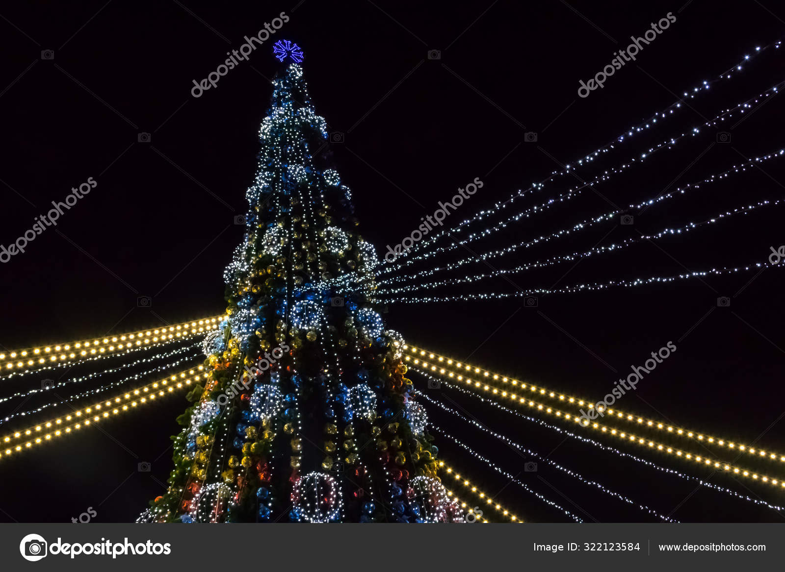 Decorated Christmas Tree With Multi Colored Lights At Night Stock Photo C Olyasolodenko 322123584