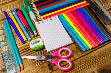 Set of school stationery supplies on a wooden desk. Back to school concept