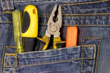 Pliers and screwdrivers in the jeans pocket